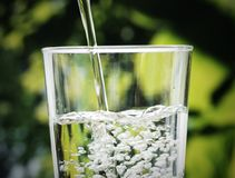 Macro shot of pouring water into a glass pure concept Royalty Free Stock Photography