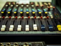 Professional audio equipment with faders knobs and buttons. Macro shot of Professional audio equipment with faders knobs and buttons stock photos