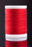 Macro shot of red bobbin thread  on black Stock Image