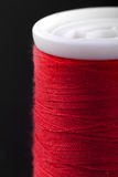 Macro shot of red bobbin thread isoladed on black Royalty Free Stock Image