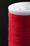 Macro shot of red bobbin thread isoladed on black Royalty Free Stock Image
