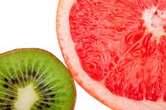 Macro shot of a red grapefruit and a kiwi isolated Royalty Free Stock Photo