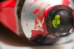 Macro shot of red paint tube. Macro shot of red metal paint tube Royalty Free Stock Photos