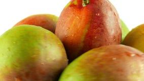 Macro Shot of Rotating Mangoes - White Background