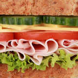 Macro shot of a sandwich with ham. Cheese, tomatoes, lettuce and cucumber Royalty Free Stock Photos