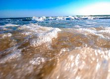 Macro shot of the sea with a little wave royalty free stock photo