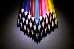 Macro Shot of Sharpened Colorful Pencils Against Black Background. Instruments for writing or drawing, consisting of a thin stick of graphite enclosed in a Stock Photography