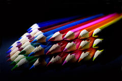 Macro Shot of Sharpened Colorful Pencils Against Black Background Stock Photos