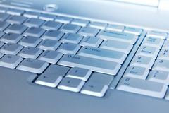 Macro shot of a silver laptop keyboard. A close-up picture of part of laptop keyboard.  stock image