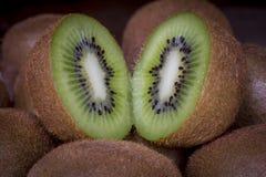 Macro shot of slit kiwi fruit stock photography