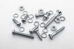 A Macro Shot of A Small Collection Of Iron Screws, Nuts and Lockwashers stock photography