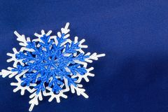Macro shot from Snowflake. Abstract winter background. Blue Stock Photography