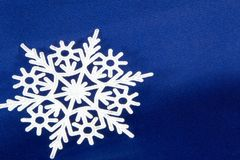 Macro shot from Snowflake. Abstract winter background. Blue Royalty Free Stock Photo