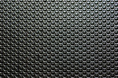 Macro shot of a speaker grille. Stock Photos