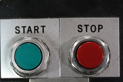 Macro shot of start and stop red and green mechanical buttons. Close up photo of machine start and stop buttons that are red and green. Go. Industrial work Royalty Free Stock Photography