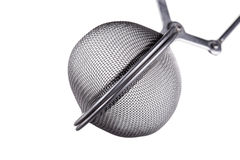 Macro shot of a tea infuser, isolated on white stock image