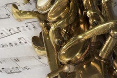 Macro Shot of Tenor Saxophone on sheet music Royalty Free Stock Image