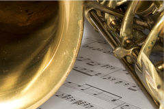 Macro Shot of Tenor Saxophone on sheet music Royalty Free Stock Photos