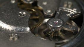 Macro shot of a ticking vintage clockwork from a pocketwatch. Macro shot of a ticking vintage clockwork from an old pocketwatch stock video