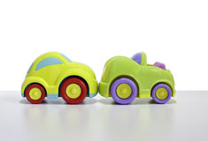 Macro shot of a toy car. Shot of a Toy plastic car with a car key attached. The toy car has no branding/manufacturer logos or company names. The car key fob has stock photo