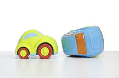 Macro shot of a toy car. Shot of a Toy plastic car with a car key attached. The toy car has no branding/manufacturer logos or company names. The car key fob has stock photos