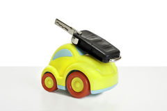 Macro shot of a toy car. Shot of a Toy plastic car with a car key attached. The toy car has no branding/manufacturer logos or company names. The car key fob has royalty free stock images