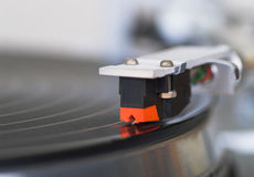 Macro shot of turntable tone-arm cartridge playing disk Stock Photo