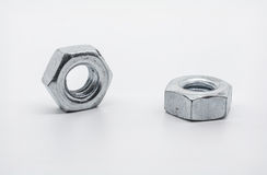 A Macro Shot of Two Lying Iron Nuts stock image