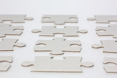 Rows of Jigsaw Puzzle Pieces Stock Photography