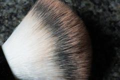 Macro shot of a used make up brush on black background Stock Photo