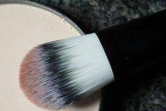Macro shot of a used make up brush on black background Stock Image