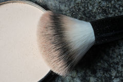 Macro shot of a used make up brush on black background Stock Photos