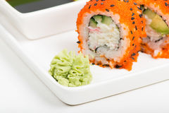 Macro shot of wasabi with rolls on background Stock Images