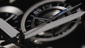 Macro shot of watch with second hand passing. Clock face rack focus. Modern men`s wristwatch with second hand. 4k. Macro shot of watch with second hand passing stock video footage