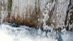 Macro shot water flow falling down into water making foam in fountain slow motion full HD, 1080p. Macro shot of water flow falling down into water making foam in stock footage