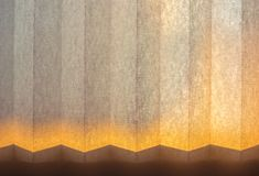Macro shot of window white paper blinds in sunset light. Abstract background royalty free stock images