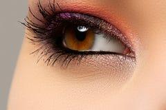 Macro shot of woman's beautiful eye, bright and deep colors make Stock Photos