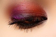 Macro shot of woman's beautiful eye, bright and deep colors make Stock Photography