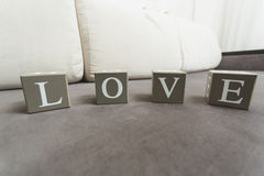 Macro shot of word Love spelled by letters on wooden bricks Royalty Free Stock Images