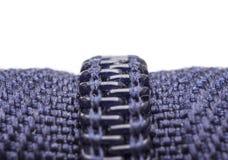 Macro shot of zipper. Purple zipper over white background Royalty Free Stock Photography