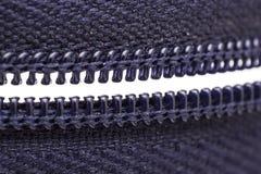 Macro shot of zipper. Purple zipper over white background Stock Photography