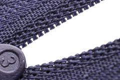 Macro shot of zipper. Purple zipper over white background Stock Photos
