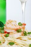 Macro shrimp with noodles and white wine Stock Photo