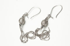 Macro of silver earrings stock images