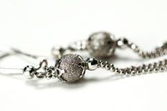 Macro of silver earrings Stock Photography