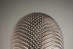 Macro Silver Microphone on White Background. A silver microphone on white background royalty free stock image