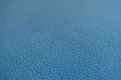 Macro of blue polar fleece fabric. Macro of sky blue polar fleece fabric Royalty Free Stock Photos