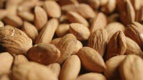 Macro slide shot of pile of almonds. 4K stock video footage