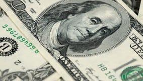 Macro sliding over dollar bills stock video