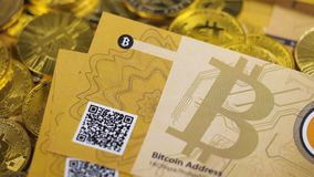 Annonimous Currency Bitcoins Fall down on Coins. Macro slow motion first annonimous currency bitcoin banknote falls down on gold coins pile stock video